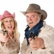 Man and woman aiming guns — Foto Stock