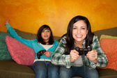 Hispanic Woman and Girl Playing Video game — ストック写真