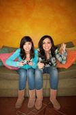 Hispanic Woman and Girl Playing Video game — Stock Photo