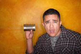 Hispanic man with tin can telephone — Stock Photo