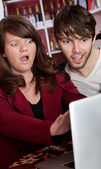 Woman reacting to content on a the laptop — Stock Photo