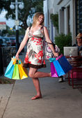 Cute pregnant woman shopping — Stock Photo