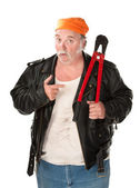 Fat theif with big red bolt cutter tool — Stock Photo