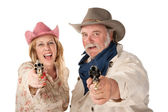 Man and woman aiming guns — Stock Photo