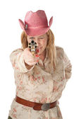 Woman with pink cowboy hat pointing a loaded pistol — Stock Photo