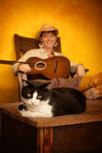 Pretty Western Woman with Guitar and cat — Stock Photo
