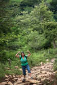 Female hiker flexing on a rugged rustic trail in Costa Rica — Stock Photo