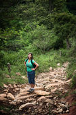 Female hiker on a rugged rustic trail in Costa Rica — Stock Photo