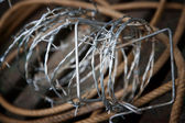 Barbed wire and rope — Stock Photo