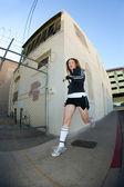 Pretty, stylish jogger run in the city — Stock fotografie
