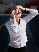 Pretty exasperated woman talks on cell phone — Stock Photo