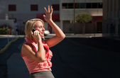 Pretty girl has ah-ha moment talking on cell phone — Stok fotoğraf