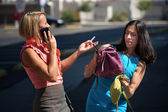 Pretty women multitask downtown. — Stock Photo