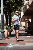 Single, handsome male running — Stock Photo