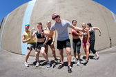 Man posing with fellow athletes — Stock Photo