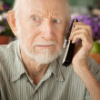 Stock Photo: Grumpy senior mon telephone