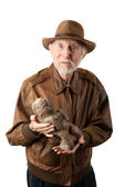 Adventurer or archaeologist with idol — Stock Photo