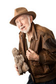 Adventurer or archaeologist offering to sell idol — Stock Photo