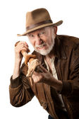 Adventurer or archaeologist defending himself — Stock Photo