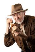 Adventurer or archaeologist defending himself — Stock Photo