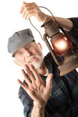 Railroad man holding lantern — Photo