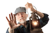 Railroad man holding lantern — Stockfoto