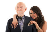 Rich elderly man with wife — Stockfoto