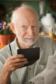 Senior man with many bills — Stock Photo