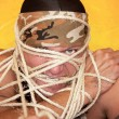 Stock Photo: Mwrapped in ropes