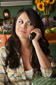 Frustrated Latina Woman on Phone — Stock Photo