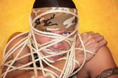 Man wrapped in ropes — Stock Photo