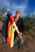 Native American man with colorful flags — Stock Photo