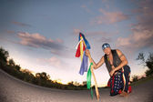 Indigenous man with ceremonial pole — Stock Photo
