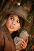 Pretty adventurer with stolen relic — Stock Photo