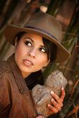 Pretty adventurer with stolen relic — Stock Photo