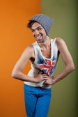 Cute, smiling boy in hat, tank, and jeans — Stock Photo