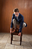 Man Stands On Chair — Stock Photo