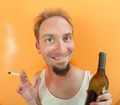 Man with alcohol and cigarette — Stock Photo