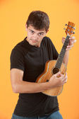 Serious Teen ukulele player — Stock Photo
