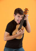 Young ukulele player — Stock Photo