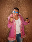 Man in Pink Jacket Listens to Music — Stock Photo