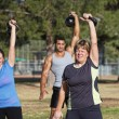 Middle Aged Woman Lifting Weights — Stock Photo