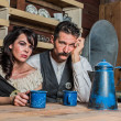 Sad Western Sheriff and Woman Pose Inside House — Stock Photo