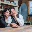 Serious Western Sheriff and Woman Pose Inside House — Stock Photo