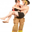 Sexy firefighter rescues a handsome man — Stock Photo #40621073