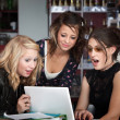 Stock Photo: Surprised Girls Looking at Laptop