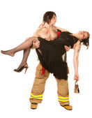Sexy fireman rescuing pretty woman — Stock Photo