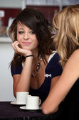 Cute looking girl in a Cafe — Stock Photo