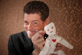 Man with a Voodoo doll — Stock Photo