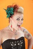 Woman with tattoos and pierced tongue — Stock Photo